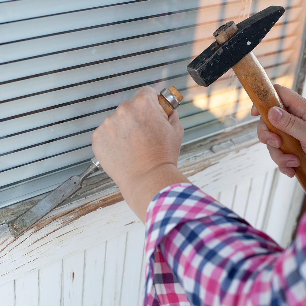 man fixing sash windows